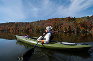 Paddling on Cedar Creek Reservoir, Catawba River at Great Falls, SC. Land around lake protected by Katawba Valley Land Trust forever