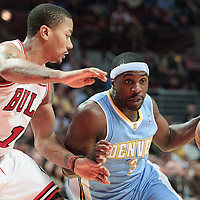 08 November 2010: Denver Nuggets' point guard #3 Ty Lawson drives past Chicago Bulls' point guard #1 Derrick Rose during the Chicago Bulls 94-92 victory over the Denver Nuggets at the United Center, in Chicago, Illinois, USA.