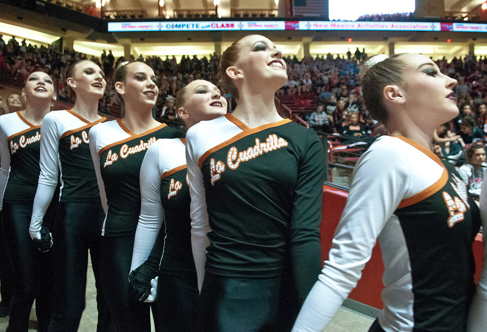 Members of Eldorado High's La Cuadrilla dance team walk onto the floor of The Pit to compete in the the State Spirit Championships in Albuquerque, N.M., Saturday, March 25, 2017. Eldorado took second in the Class 6A competition. (Marla Brose/Albuquerque Journal)