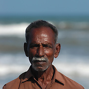 An unemployed fisherman stands with his back to the ocean in the fishing village of Chinnangudi in Tamil Nadu, India on January 16, 2005, after the area was struck by the Indian Ocean Tsunami on December 26, 2004. Generated by an earthquake on the ocean floor, the tsunami devastated the fishing industry along the southeastern coast of India. .