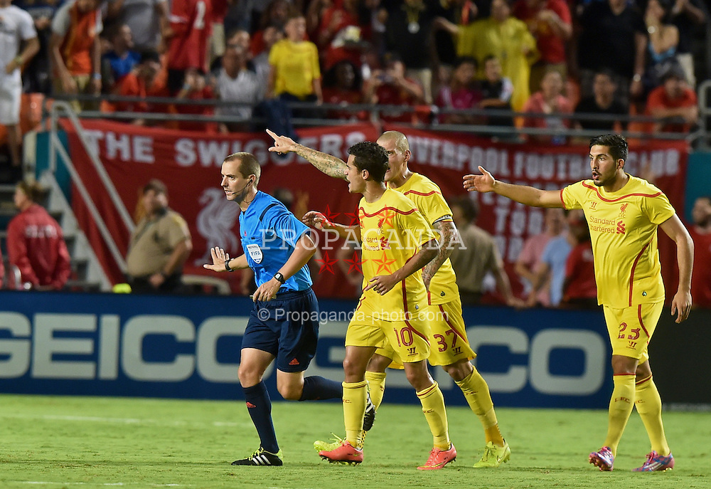 MIAMI, USA - Monday, August 4, 2014: Liverpool players complain to referee Mark Geiger after he awarded Manchester United a goal despite the ball going out of play during the International Champions Cup Final match at the SunLife Stadium on day fifteen of the club's USA Tour. (Pic by David Rawcliffe/Propaganda)