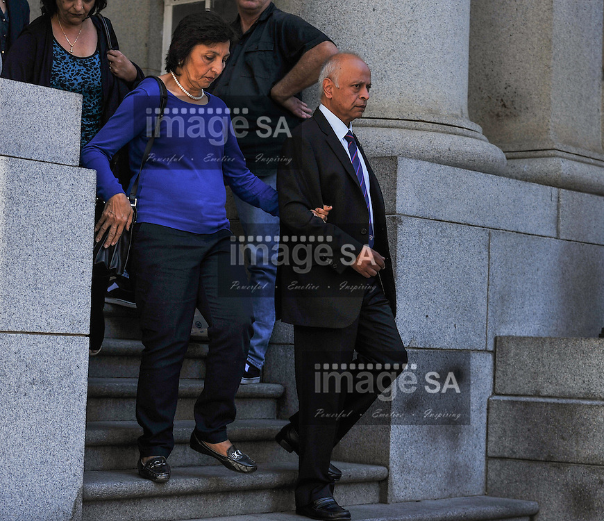 CAPE TOWN, SOUTH AFRICA - Monday 13 October 2014,  Snila and Prakash Dewani, parents of Shrien Dewani, leave the court after Day 4 of the Shrien Dewani trial at the Cape High Court before Judge Jeanette Traverso. Dewani is caused of hiring hit men to murder his wife, Anni. Anni Ninna Dewani (n&eacute;e Hindocha; 12 March 1982 &ndash; 13 November 2010) was a Swedish woman who, while on her honeymoon in South Africa, was kidnapped and then murdered in Gugulethu township near Cape Town on 13 November 2010 (wikipedia).<br /> Photo by Roger Sedres