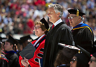 Chancellor Rebecca Blank and Jon Huntsman, Jr. smile before taking the stage at the University of Wisconsin-Madison commencement ceremony at Camp Randall Stadium, Saturday, May 17, 2014. Huntsman, the former Governor of Utah, gave the commencement address to graduating Class of 2014.