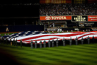 The American Flag is displayed in Center Field of Yankees Stadium  during the US National Anthem prior to Game 1 of the 2009 World Series between the New York Yankees and The Philadelphia Phillies in Bronx, NY. (Photo by Robert Caplin)..