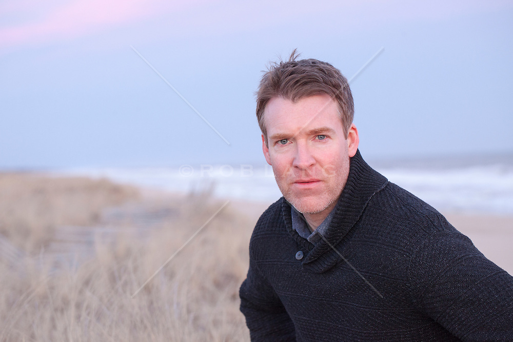 portrait of a a man with a serious expression while at the beach in East Hampton, NY