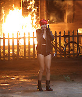 "July 21st  2010 Los Angeles, CA. ***EXCLUSIVE*** Rihanna performs in front of a burning house while filming a music video with Eminem  for ""The Way You Lie"". Eminem was later seen but not photographed performing together with Rihanna in front of the burning house. Photo by Danny Mayer/ Eric Ford/ On Location News 818-613-3955 info@onlocationnews.com"