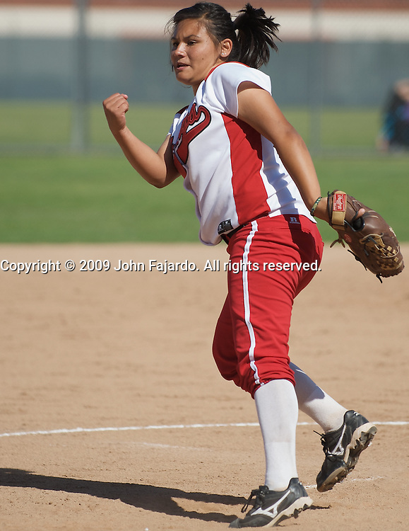 Christine Gonzalez pitches for LBCC in the game against South Coast Conference rival El Camino College at the LBCC Softball Field on Tuesday April 7, 2009.  The Vikings win 10-0 when El Camino failed to score in the fifth inning.