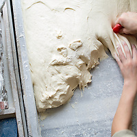 Dividing dough for pides.