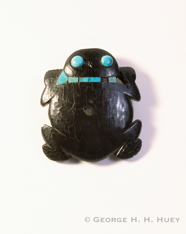 0204-1050 ~ Copyright: George H. H. Huey ~ Jet frog with inlaid turquoise. Anasazi culture era. Recovered from Pueblo Bonito by the Hyde Expedition. Chaco Culture National Historical Park, New Mexico.