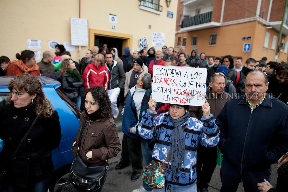 Anti-eviction supporters stand outside Vicente's appartment building on April 18 2012, in Madrid, Spain. Spanish Vicente Torres, 73, who is severely ill and underwent a recent heart surgery, and is waiting for a thrombus surgery faces an eviction from his house after he endorsed his son, so Citibank would concede a credit to buy a house. His son already handed his house to the bank. Torres has lived at his home for the last 55 years and was paying it for 30 years. Eviction procedures in Spanish courts for unpaid mortgages and rent hit a record of 58,241 in 2011, a 21.2 percent rise over the previous year. Evictions have soared in Spain since the collapse of a property bubble in 2008 that triggered the country's economic crisis.