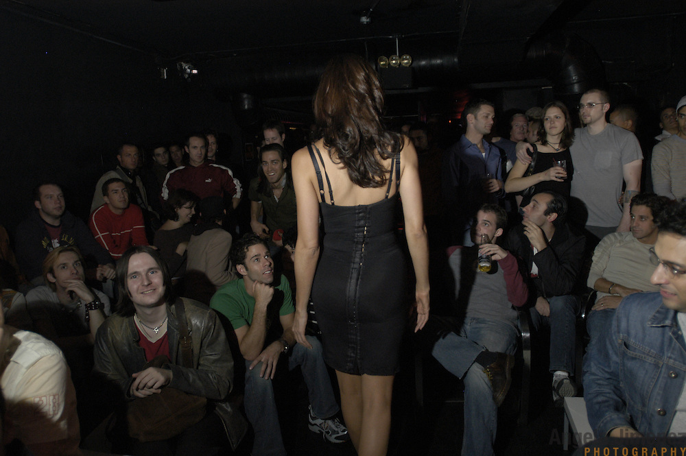 DATE: 10/18/04<br />DESK: METRO<br />SLUG: CAYNE<br /><br />Transexual performer Candis Cayne walks into the audience during her one-woman Candis Cayne Show at the Barracuda club in Chelsea, Manhattan.<br /><br />photo by Angela Jimenez for The New York Times<br />photographer contact 917-586-0916
