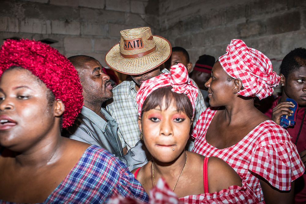 Vodou worshipers attend a nighttime a ceremony on Sunday, December 14, 2014 in Leogane, Haiti. The city of Leogane, about 20 miles west of Port-au-Prince, was the closest city to the epicenter of the 2010 earthquake, and damage there was extensive.