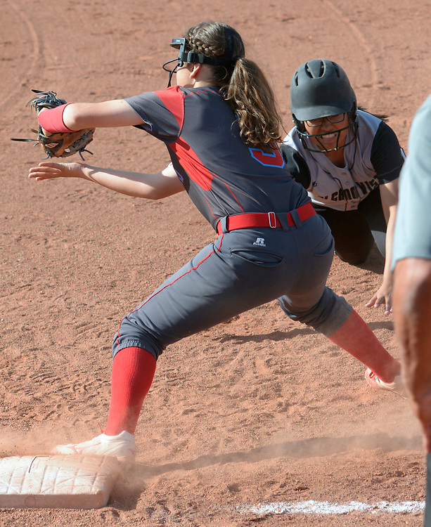 gbs032117j/SPORTS -- Sandia's Jayleen Burton catches Volcano Vista's Audry Jim off first base in the 3rd inning during the game at Volcano Vista on Tuesday, March 21, 2017. (Greg Sorber/Albuquerque Journal)
