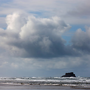 Storm clouds, including cumulus congestus, form over Castle Rock in this view from Hug Point on the northern Oregon coast. Within an hour, these storm clouds produced heavy rain.