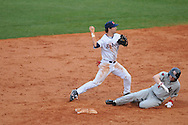 Arkansas State's Ryan Emery (1) is forced out at second  by Ole Miss' Blake Newalu (6) at Oxford University Stadium in Oxford, Miss. on Wednesday, February 23, 2011.