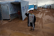 A  Syrian refugee child during stormy weather  at the Za'atri Syrian refugee camp in northern Jordan February 6,2013. ..Jordan  recently announced  that the number of Syrian refugees in the country is expected to exceed 700, 000 in 2013, the state-run Petra news agency reported. (Photo by Heidi Levine/Sipa Press).