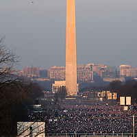 People begin filing onto the National Mall as the sun rises, Tuesday,  January 20, 2009.