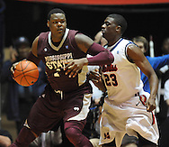 "Mississippi State's Renardo Sidney (1) works against Mississippi's Reginald Buckner (23) at the C.M. ""Tad"" Smith Coliseum in Oxford, Miss. on Wednesday, January 18, 2012. (AP Photo/Oxford Eagle, Bruce Newman)."