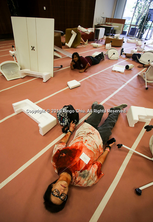 A mock victim waits for rescue during the annual Great California ShakeOut earthquake drill at Southern California University (USC) in Los Angeles on October 15, 2015. About 10.4 million Californian's registered to take part in the annual drill that asks participants to 'drop'' to the ground, take 'cover'' under a desk, table or other sturdy surface, and 'hold on'' for 60 seconds, as if a major earthquake were occurring.(Photo by Ringo Chiu/PHOTOFORMULA.com)
