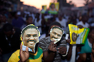 Supporters hold signs showing the face of Haitian presidential candidate Jude Celestin at a rally on Friday, November 26, 2010 in Port-au-Prince, Haiti.