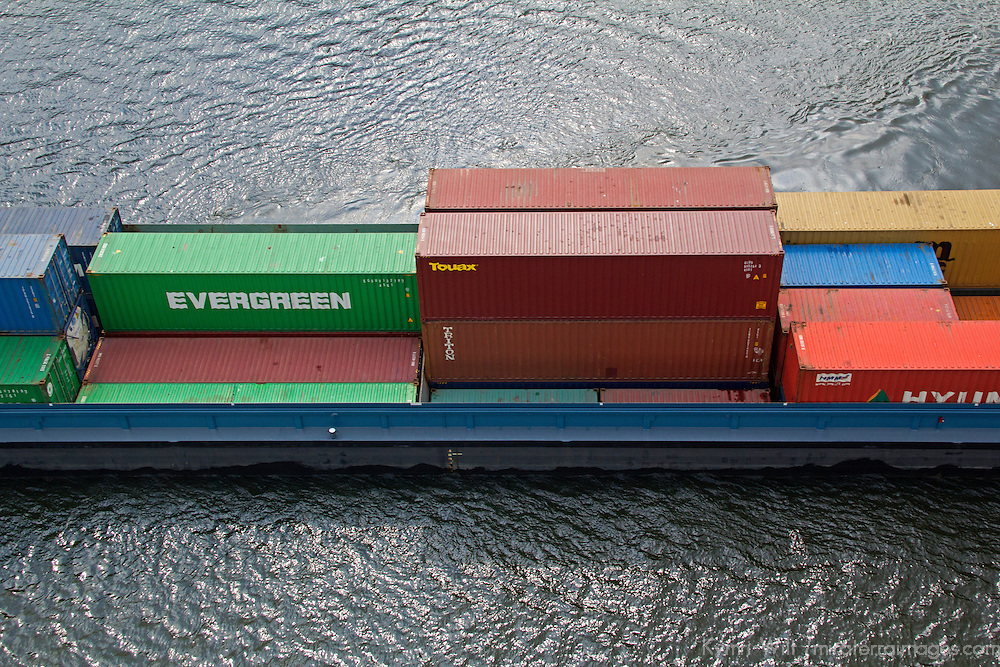 Europe, Netherlands, Amsterdam. Container Freighter near Amsterdam.