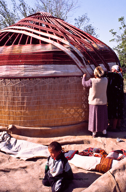 The first step in assembling a yurt is to attach the lattice wall sections to the door frame as villagers are doing here in Shieli in  the Qizilorda region.  The door of a yurt always looks to the east so that the sun is the first visitor to the nomad's home.