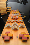 An assortment of Sushi on a wooden tray
