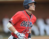 Mississippi's Matt Snyder (33) hits a grand slam in the ninth inning vs. St. John's during an NCAA Regional game at Davenport Field in Charlottesville, Va. on Sunday, June 6, 2010. St. John's won 20-16.