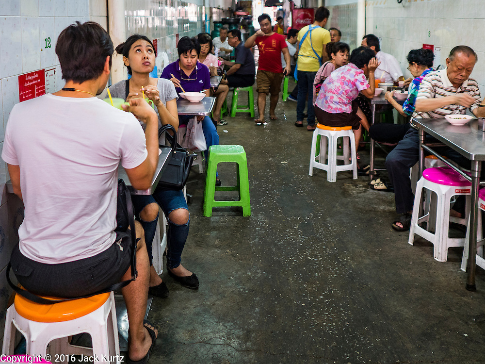 03 FEBRUARY 2016 - BANGKOK, THAILAND: People eat fish noodle soup from a street food stall in an alley in Bangkok's Chinatown.        PHOTO BY JACK KURTZ