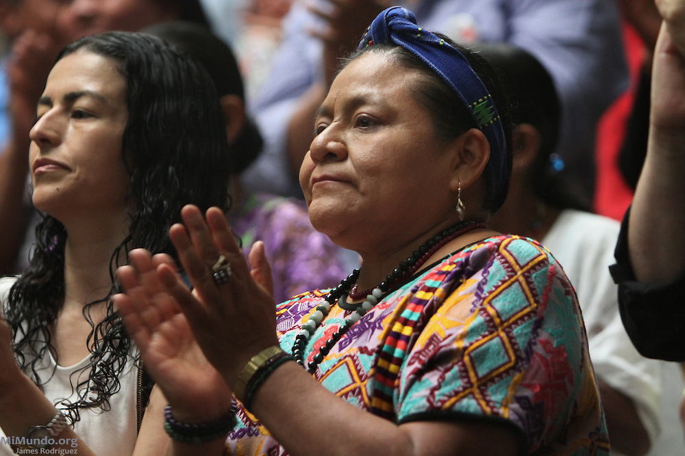 Nobel Peace Prize laureate Rigoberta Menchu claps after Judge Jazmin Barrios declares that Judge Flores' annulment is illegal and will be asking the Constitutional Court, Guatemala's highest judicial body, to rule on the fate of the genocide trial. Guatemala, Guatemala. April 19, 2013.