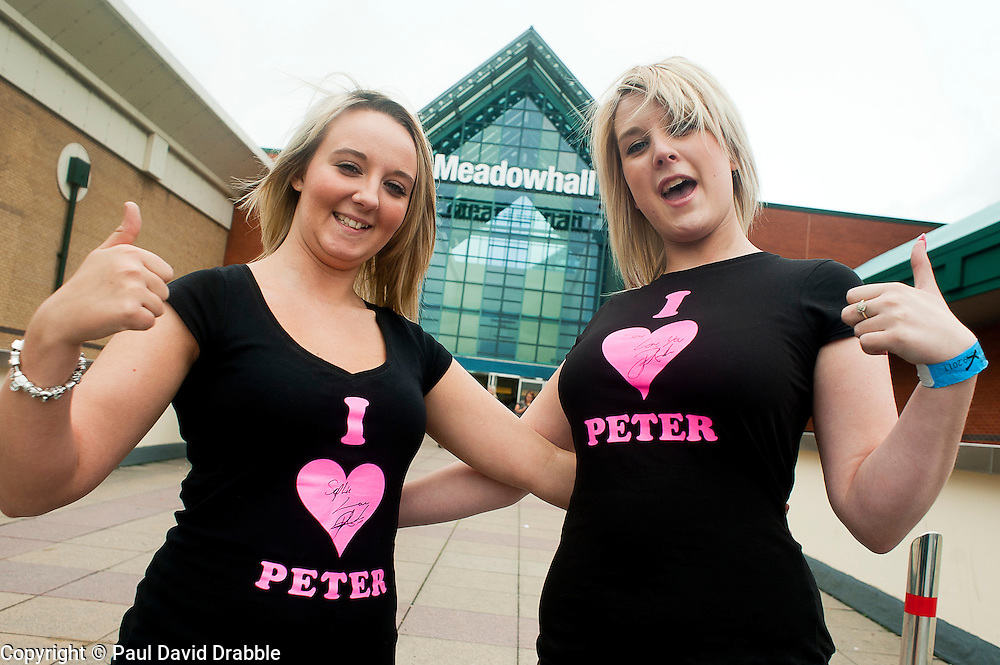 """Fans Sophie Greaves (left) and Samantha Parfitt (right) who traveled from Newark setting off at 6:00am to ensure they were at meadowhall in time to get their hand on a wristband and meet their Idol Peter Andre who was signing copies of his new childrens books """"The Happy Birthday Party"""" and """"A New Day at School"""" in WH Smiths Sheffield on 6th September2011 .Image © Paul David Drabble"""