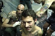©Stefano Meluni.23-12-2005 Naples Italy..Un gruppo di giovani artisti della Body Art, Bloody Freaks, si fa sospendere con dei ganci nella pelle al soffitto di un locale di Napoli, il Mutiny Report. Coperti di tatuaggi e piercing, con le loro performance stanno facendo il giro d'Italia e d'Europa, mettendo in scena uno spettacolo che pur essendo raccapricciante esprime un sentimento di disagio e dolore mistico. .foto di: © stefano meluni