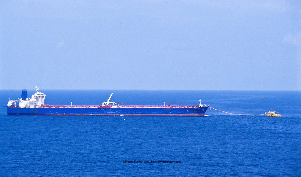 Super tanker loading gas at a SPM buoy offshore of Angola.