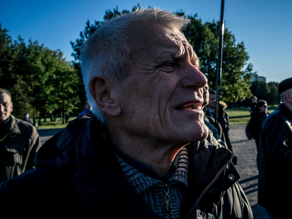 A man attends a rally by indpendent union workers for better pay and jobs, held in a park on the north end of the city out of view of most people, on Wednesday, October 7, 2015 in Minsk, Belarus. A presidential election is planned for Sunday with current president Alexander Lukashenko expected to secure a fifth term, though as in the past, the election is not expected to be declared free by monitors or the opposition.