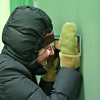 MR-Model released photo of a Russian young woman peeking through a door opening
