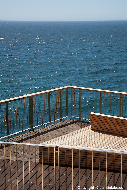 The cantilevered boardwalk is just 550 metres long but cost more than $2.5 million to build. The mostly stainless steel and wooden construction hugs the cliff edge and has five viewing platforms for those more inclined to sit and think than sprint past..The timber is designed to age so it blends in with the environment and some of the pathway is made of fibreglass decking to allow sunlight and rain through to the vegetation below.''.Built in 2009 The track is called the Sesqui Centenary Boardwalk, to commemorate the council's 150th anniversary this year. The boardwalk is part of the Coogee to Bondi beach Coastal walk
