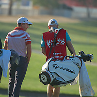 19.01.2013 Abu Dhabi, United Arab Emirates.  Steve Webster talking with caddie during the European Tour HSBC Golf championship  third round from the Abu Dhabi Golf Club.