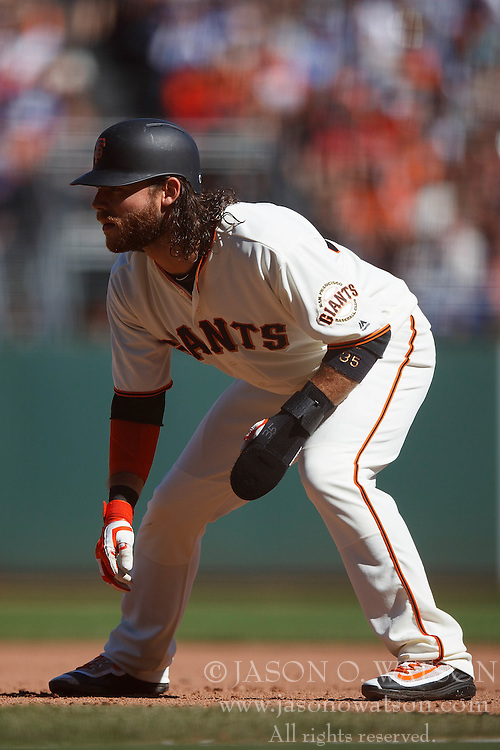 SAN FRANCISCO, CA - OCTOBER 02: Brandon Crawford #35 of the San Francisco Giants leads off first base against the Los Angeles Dodgers during the seventh inning at AT&T Park on October 2, 2016 in San Francisco, California. The San Francisco Giants defeated the Los Angeles Dodgers 7-1. (Photo by Jason O. Watson/Getty Images) *** Local Caption *** Brandon Crawford