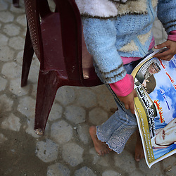 Yara Al-Athamneh, 6, holds a photo of her grandfather who was killed by Israeli artillery fire, Beit Hanoun, Gaza Strip, Palestinian Territories, Nov. 16, 2006. Israel blames the incident on a targeting error and expresses regret. According to Human Rights Watch, since September 2005, Israel has fired about 15,000 rounds at Gaza while Palestinian militants have fired around 1,700 back.