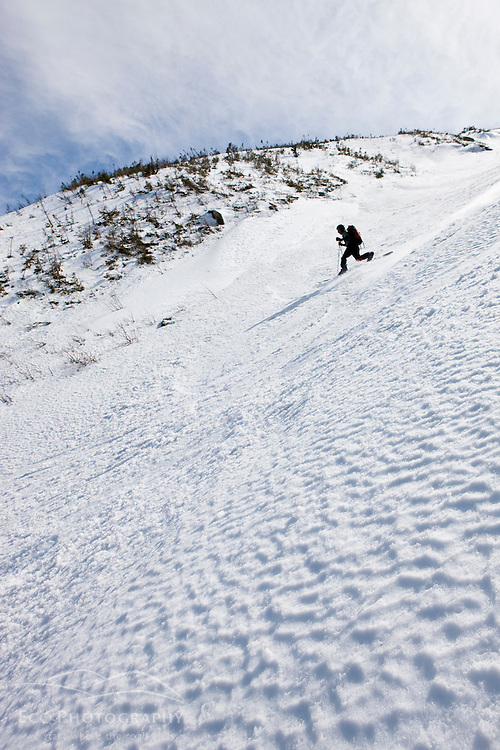 """Telemark skiing """"The Seven"""" in the Great Gully on the headwall of King Ravine in New Hampshire's White Mountains.  King Ravine is a glacial cirque on the north side of Mount Adams.  Backcountry spring skiing."""