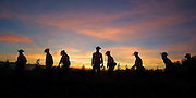 Oregon National Guard soldiers from Team Alpha make their way up towards the Sheldon Ridge fire as they lay hose for several miles on their first night out on the fire lines.