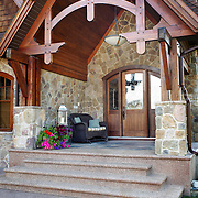 Photos of stone luxury home in Calgary, Alberta made with Cultured Stone faux stone product by Boreal.
