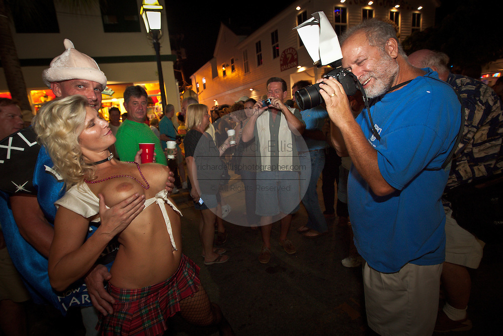 A topless reveler during Fantasy Fest halloween parade in Key West, Florida.