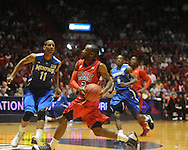 "Mississippi's Chris Warren vs. Memphis's Wesley Witherspoon (11) in NIT second round basketball action at the C.M. ""Tad"" Smith Coliseum in Oxford, Miss. on Friday, March 19, 2010. Ole Miss won 90-81."