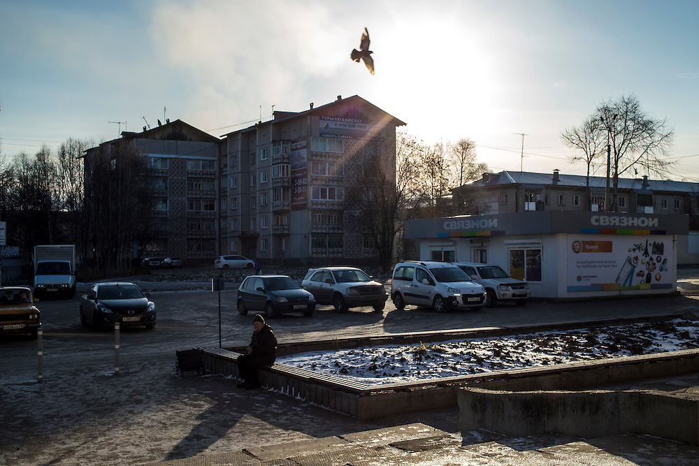 A pigeon flies overhead in the town's central square on Tuesday, October 22, 2013 in Baikalsk, Russia.