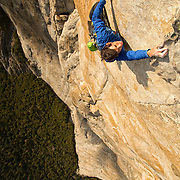 Alex Honnold free climbing the Headwall Pitch (13b) of the Salathe Wall on El Capitan, Yosemite National Park.