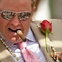 Robert Hyde, from Avon, Ct., visited with other Derby-goers while smoking a Hyde cigar in the paddock at the 138th running of the Kentucky Derby at Churchill Downs in Louisville, Ky. Saturday May 5, 2012.  Photo by David Stephenson
