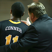 Guard (#11) Dre Conner and Towson head coach Pat Kennedy talk during a time out. Delaware defeated Towson 80-70 at The Bob Carpenter Center Wednesday night In Newark Delaware.