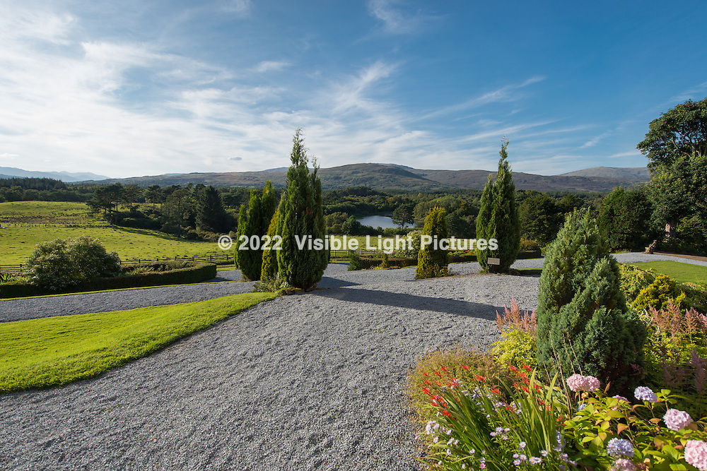This is the view from outdoor dining area at the rear of the castle. The lake is in the center and a sheep pasture is on the left. The gardens were magnificent.
