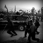 Islamabad. Navaz Sharif is defend his bodyguard on the rally, before the election. He was twice elected as Prime Minister of Pakistan, serving two non-consecutive terms, the first from November 1, 1990 to July 18, 1993 and the second from February 17, 1997 to October 12, 1999. His party is the Pakistan Muslim League N (Nawaz group). He is best known internationally for ordering Pakistan's 1998 nuclear tests in response to India's nuclear tests,  his conduct of the Kargil War against India, and the abrupt end of his final term in a dramatic coup by General Pervez Musharraf.